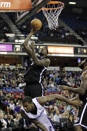 photo -   Brooklyn Nets forward Andray Blatche, top left, shoots over Sacramento Kings' Thomas Robinson during the first quarter of an NBA basketball game in Sacramento, Calif., Sunday, Nov. 18, 2012. (AP Photo/Rich Pedroncelli)