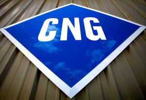 photo - Sign in front of CNG Interstate, an Edmond business that specializes in compressed natural gas conversions.  Photo by Jim Beckel, The Oklahoman. ORG XMIT: KOD
