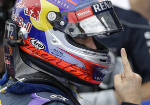 Photo - Red Bull driver Sebastian Vettel of Germany gestures as he celebrates after qualifying in pole position at the Korean Formula One Grand Prix at the Korean International Circuit in Yeongam, South Korea, Saturday, Oct. 5, 2013. (AP Photo/Lee Jin-man)