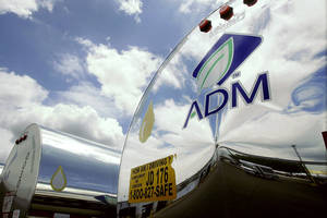photo - FILE - In this July 2, 2009 file photo, the ADM logo is seen on a tanker truck which carries mostly corn syrup at the Archer Daniels Midland Company plant in Decatur, Ill. Agribusiness conglomerate Archer Daniels Midland Co. announced Monday, Dec. 3, 2012, it is increasing its buyout offer for GrainCorp by almost 4 percent and disclosed it has already added to its stake in the Australian grain handler. (AP Photo/Seth Perlman, file)