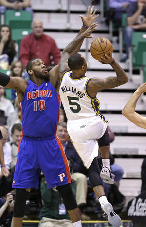 Photo - Utah Jazz's Mo Williams (5) shoots as Detroit Pistons' Greg Monroe (10) defends in the first quarter during an NBA basketball game Monday, March 11, 2013, in Salt Lake City.  (AP Photo/Rick Bowmer)