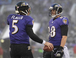 Photo - Baltimore Ravens tight end Dennis Pitta, right, celebrates his touchdown with quarterback Joe Flacco in the second half of an NFL football game against the Minnesota Vikings, Sunday, Dec. 8, 2013, in Baltimore. Baltimore won 29-26. (AP Photo/Nick Wass)