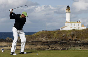 Photo - FILE - In this July 19, 2009, file photo, Stewart Cink, of the Unites States, plays from the ninth tee during the final round of the British Open Golf championship, at the Turnberry golf course in Scotland. American developer Donald Trump has agreed to buy Turnberry Resort, famous for its Ailsa Course that has hosted the British Open three times. Terms of the deal were not disclosed. The Independent in London reported that Trump paid Dubai-based Leisurecorp just over $63 million (37.5 million pounds). (AP Photo/Peter Morrison, File)