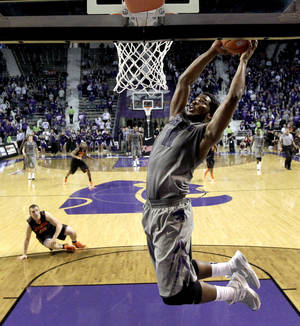 Photo - Kansas State forward Nino Williams (11) dunks the ball during the second half of an NCAA college basketball game against Oklahoma State, Saturday, Jan. 5, 2013, in Manhattan, Kan. Kansas State won 73-67. (AP Photo/Charlie Riedel) ORG XMIT: KSCR114