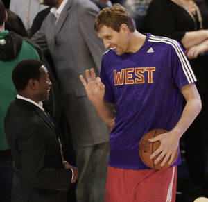 Photo - Former NBA player Avery Johnson, left speaks with West Team's Dirk Nowitzki, of the Dallas Mavericks (41) before the NBA All Star basketball game, Sunday, Feb. 16, 2014, in New Orleans. (AP Photo/Bill Haber)