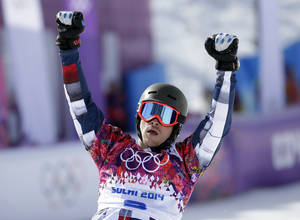 Photo - Russia's Vic Wild celebrates his win in a snowboard parallel slalom quarterfinal at the Rosa Khutor Extreme Park, at the 2014 Winter Olympics, Saturday, Feb. 22, 2014, in Krasnaya Polyana, Russia. (AP Photo/Andy Wong)