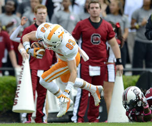 Photo -   Tennessee tight end Zach Rogers scoots his way into the end zone for a touchdown during an NCAA college football game against South Carolina, Saturday, Oct. 27, 2012 at Williams-Brice Stadium in Columbia, S.C. South Carolina won 38-35. (AP Photo/Richard Shiro)