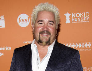 "Photo -   This Oct. 11, 2012 file photo shows chef Guy Fieri at the ""On The Chopping Block: A Roast of Anthony Bourdain"" in New York. (Photo by Charles Sykes/Invision/AP)"