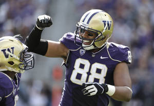 Photo - Washington's Austin Seferian-Jenkins (88) celebrates his touchdown against Idaho State with Kevin Smith in the first half of an NCAA college football game Saturday, Sept. 21, 2013, in Seattle. (AP Photo/Elaine Thompson)