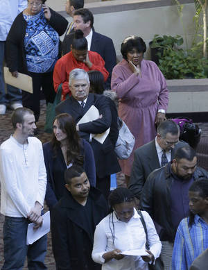 Photo - Job seekers line up to meet prospective employers at a career fair at a hotel in Dallas, Wednesday, Jan. 22, 2014. The Labor Department reports Thursday March 13, 2014 on the number of people who applied for unemployment benefits last week (AP Photo/LM Otero)