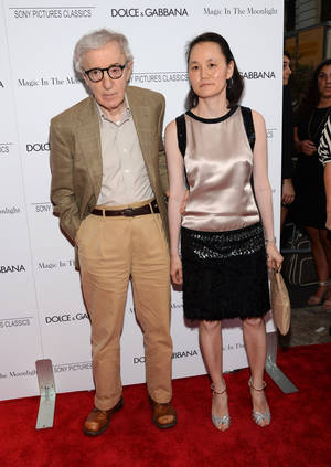 In this Thursday, July 16, 2014 photo, Writer/Director Woody Allen and Soon-Yi Previn arrive at the premiere of Magic In The Moonlight in New York. Hollywood may be an industry driven by youth, but this summer has brought a rush of releases from directors working well into their late 70s and early 80s. The 78-year-old Allen, whose latest, Magic in the Moonlight, opens Friday, July 25, 2014, follows films from Clint Eastwood (84), Roman Polanski (80) and Jean-Luc Godard (83). (Photo by Evan Agostini/Invision/AP, file)
