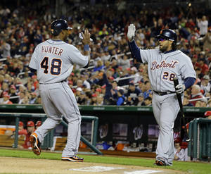 Photo - Detroit Tigers' Torii Hunter (48) celebrates scoring with Prince Fielder (28) during the third inning of a baseball game against the Washington Nationals at Nationals Park, Wednesday, May 8, 2013, in Washington. (AP Photo/Alex Brandon)