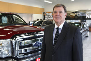 Photo -      Dale Daniels is president and owner of Reynolds Auto Group. He is in his Ford showroom in Edmond. Photo by David McDaniel, The Oklahoman  <strong>David McDaniel -   </strong>