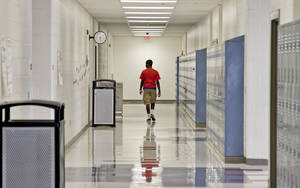 Photo - A student walks the hallway at John Marshall High School on Friday, March 30, 2012, in Oklahoma City, Okla. Photo by Chris Landsberger, The Oklahoman