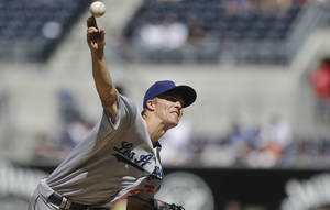 Photo - Los Angeles Dodgers starting pitcher Zack Greinke releases pitch against the San Diego Padres in the first inning of an MLB National League baseball game Sunday, Sept. 22, 2013, in San Diego. (AP Photo/Lenny Ignelzi)