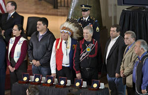 Photo - Representatives of American Indian tribes stand during a Congressional Gold Medal ceremony on Capitol Hill in Washington, Wednesday, Nov. 20, 2013, honoring Native American code talkers who used their unique languages as a means of secret communication that enemy troops could not decipher during World War II. AP photo <strong>J. Scott Applewhite - AP</strong>
