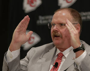 Photo - New Kansas City Chiefs NFL team head football coach Andy Reid talks to the media during a news conference at Arrowhead Stadium Monday, Jan. 7, 2013, in Kansas City, Mo. (AP Photo/Charlie Riedel)