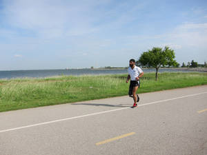 Photo - Amputee marathon runner Maj. Devender Pal Singh runs at Lake Hefner in Oklahoma City.  <strong>Carla Hinton - The Oklahoman</strong>