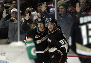 Photo - Anaheim Ducks left wing Jakob Silfverberg (33), of Sweden celebrates a goal by right wing Tim Jackman, left, during the second period of an NHL hockey game against the Edmonton Oilers on Friday, Jan. 3, 2014, in Los Angeles. (AP Photo/Alex Gallardo)