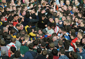 Photo - Players compete for the ball during the Royal Shrovetide Football match in Ashbourne, Derbyshire England  Tuesday, March 4, 2014 . The Royal Shorvetide Football match occurs annually on Shrove Tuesday and Ash Wednesday in the town of Ashbourne, where it has been played since at least the 12th Century. The game, which pits the two sides of Ashbourne against each other, has only around six rules some of which are  players are not allowed to commit murder or manslaughter; and the ball cannot be carried in a motorised vehicle or be hidden in a bag.  (AP Photo/Rui Vieira)