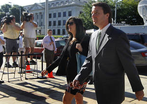 Photo -   Former Senator and presidential candidate John Edwards and his daughter Cate Edwards enter the Federal Courthouse in Greensboro, N.C. Thursday May 3, 2012. Edwards has pleaded not guilty to six counts related to campaign finance violations over nearly $1 million from two supporters used to help hide his pregnant mistress as he sought the White House in 2008. (AP Photo/The News & Observer, Chuck Liddy)