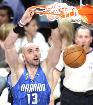 Photo - Orlando's Marcin Gortat won't cover up his Jumpman tattoo. AP photo