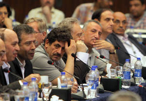 photo -   Exiled Syrian opposition figures meet in New Cairo, Egypt, Tuesday, July 3, 2012. The Arab League chief urged exiled Syrian opposition figures to unite at a meeting as a new Western effort to force President Bashar Assad from power faltered. (AP Photo/Amr Nabil)  