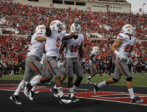 photo - CELEBRATION: Oklahoma State&#039;s Josh Stewart (5) celebrates a Cowboys fumble recovery on a kickoff during a college  football game between Texas Tech University (TTU) and Oklahoma State University (OSU) at Jones AT&amp;T Stadium in Lubbock, Texas, Saturday, Nov. 12, 2011.  Photo by Sarah Phipps, The Oklahoman  ORG XMIT: KOD