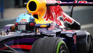 Photo - Infiniti Red Bull Racing driver Sebastian Vettel of Germany  drives the new RB10 Formula One car at the Circuito de Jerez on Tuesday, Jan. 28, 2014, in Jerez de la Frontera, Spain. (AP Photo/Miguel Angel Morenatti)