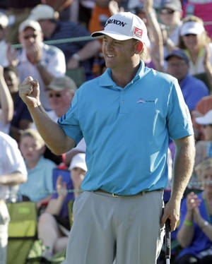 Photo - J.B. Holmes reacts after winning the Wells Fargo Championship golf tournament in Charlotte, N.C., Sunday, May 4, 2014. (AP Photo/Bob Leverone)
