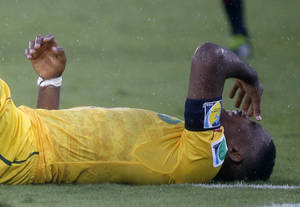 Photo - Cameroon's Samuel Eto'o reacts after taking a knock during the group A World Cup soccer match between Mexico and Cameroon in the Arena das Dunas in Natal, Brazil, Friday, June 13, 2014.  (AP Photo/Sergei Grits)