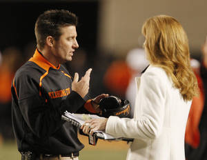 Photo - The success of coach Mike Gundy's football program is a key for Oklahoma State's athletic future. Photo by Doug Hoke, The Oklahoman
