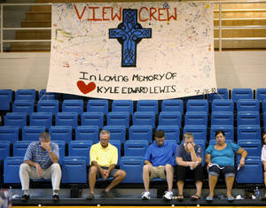 Photo - A sign hangs inside the Bethel High School gymnasium during a memorial for Kyle Lewis in Shawnee, Okla., Wednesday, July 28, 2010. Lewis was a Bethel High School student that graduated in May and died in a car wreck on Monday.  Photo by Bryan Terry, The Oklahoman