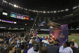 photo - San Francisco 49ers linebacker Patrick Willis is surrounded by reporters during media day for the NFL Super Bowl XLVII football game Tuesday, Jan. 29, 2013, in New Orleans. (AP Photo/Pat Semansky)