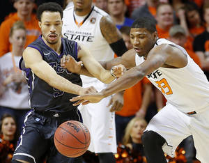 Photo - Oklahoma State's Marcus Smart (33) goes for the ball beside TCU's Kyan Anderson during an NCAA college basketball game between Oklahoma State University (OSU) and TCU at Gallagher-Iba Arena in Stillwater, Okla., Wednesday, Jan. 15, 2014.  Photo by Bryan Terry, The Oklahoman