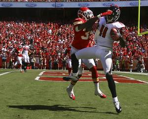 Photo -   Atlanta Falcons wide receiver Julio Jones (11) catches a touchdown pass while covered by Kansas City Chiefs defensive back Jacques Reeves (35) during the first half of an NFL football game at Arrowhead Stadium in Kansas City, Mo., Sunday, Sept. 9, 2012. (AP Photo/Ed Zurga)