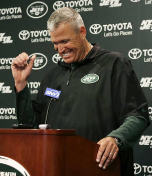 Photo - New York Jets head coach Rex Ryan laughs as he listens to a question after team's NFL football practice in Florham Park, N.J., Monday, Sept. 2, 2013.  (AP Photo/Mel Evans)