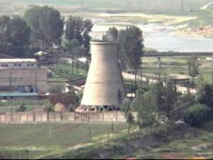 Photo - FILE - In this June 27, 2008 file photo from television, the 60-foot-tall cooling tower is seen before its demolition at the main Nyongbyon reactor complex in Nyongbyon, also known as Yongbyon, North Korea. (AP Photo/APTN, File)
