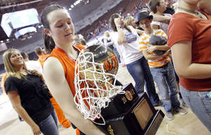 Photo - Fairview's Kaydee Stafford (12) carries the Gold Ball Trophy after the win over Northeast in the 2A girls State Basketball Championship game between Northeast High School and Fairview High School at State Fair Arena on Saturday, March 10, 2012 in Oklahoma City, Okla.  Photo by Chris Landsberger, The Oklahoman
