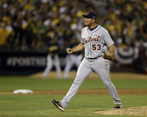 Photo - Detroit Tigers pitcher Joaquin Benoit shouts after striking out the last batter in the ninth inning for a 3-2 win over the Oakland Athletics in Game 1 of the American League baseball division series in Oakland, Calif., Friday, Oct. 4, 2013. (AP Photo/Ben Margot)