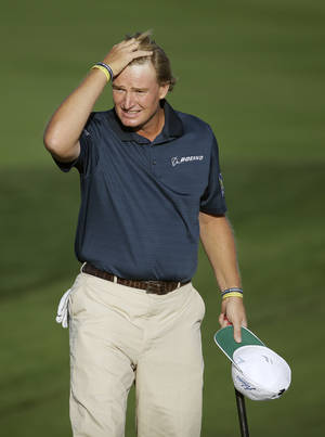 Photo - Ernie Els, of South Africa, wipes his head after winning his match against Justin Rose, of England, during the second round of the Match Play Championship golf tournament on Thursday, Feb. 20, 2014, in Marana, Ariz. (AP Photo/Ted S. Warren)
