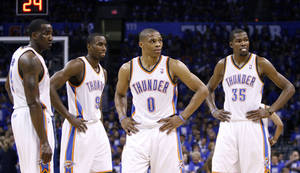 photo - NBA BASKETBALL: Oklahoma City's Kendrick Perkins (5), Serge Ibaka (9, Russell Westbrook (0) and Kevin Durant (35) talk during Game 3 of the Western Conference Finals between the Oklahoma City Thunder and the San Antonio Spurs in the NBA playoffs at the Chesapeake Energy Arena in Oklahoma City, Thursday, May 31, 2012.  Photo by Sarah Phipps, The Oklahoman