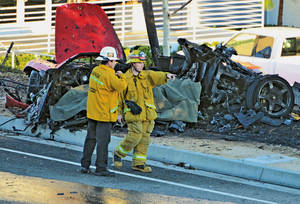"Photo - Sheriff's deputies work near the wreckage of a Porsche that crashed into a light pole on Hercules Street near Kelly Johnson Parkway in Valencia, Calif., on Saturday, Nov. 30, 2013. A publicist for actor Paul Walker says the star of the ""Fast & Furious"" movie series died in the crash north of Los Angeles. He was 40. Ame Van Iden says Walker died Saturday afternoon. No further details were released. (AP Photo/The Santa Clarita Valley Signal, Dan Watson)"
