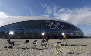 Photo - A television studio is set up in front of the Bolshoy Ice Dome, where the ice hockey will be held, ahead of the 2014 Winter Olympics, Tuesday, Feb. 4, 2014, in Sochi, Russia. (AP Photo/Petr David Josek)
