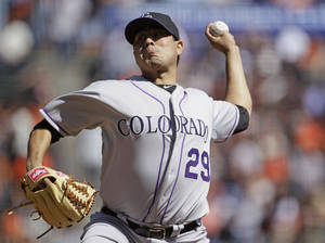 Photo -   Colorado Rockies starting pitcher Jorge De La Rosa throws to a San Francisco Giants batter during the first inning of a baseball game in San Francisco, Thursday, Sept. 20, 2012. (AP Photo/Eric Risberg)