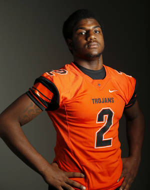 Photo - All-State and Little All-City high school football player Deondre Clark of Douglass has chosen LSU as his college destination. Photo by Nate Billings, The Oklahoman