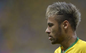 Photo - Brazil's Neymar pauses during the World Cup quarterfinal soccer match between Brazil and Colombia at the Arena Castelao in Fortaleza, Brazil, Friday, July 4, 2014. (AP Photo/Manu Fernandez)