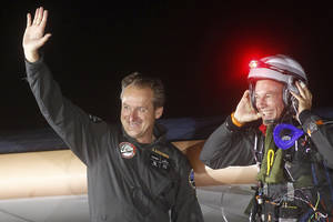Photo -   Solar Impulse pilots Bertrand Piccard, right, and Andre Borschberg, left, are all smiles upon arrival at Rabat airport, Morocco, Tuesday, June 5, 2012. The experimental solar-powered airplane landed in Morocco's capital late Tuesday after a 20-hour trip from Madrid in the first transcontinental flight by a craft of its type. The mission is being described as a final dress rehearsal for a round-the-world flight with a new and improved plane in 2014. (AP Photo/Abdeljalil Bounhar)