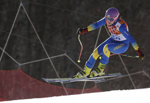 Photo - In this Saturday, Feb. 15, 2014 photo, Ukraine's Bogdana Matsotska makes a jump in the women's super-G at the Sochi 2014 Winter Olympics in Krasnaya Polyana, Russia. The International Olympic Committee said on Thursday, Feb. 20, that Matsotska has left the Olympics in response to the violence in her country. (AP Photo/Charles Krupa)