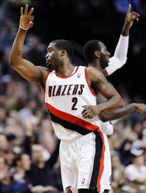 photo - Portland Trail Blazers guard Wesley Matthews, left, celebrates with J.J. Hickson after hitting a 3-pointer during the first quarter of an NBA basketball game against the Orlando Magic in Portland, Ore., Monday, Jan. 7, 2013. (AP Photo/Don Ryan)
